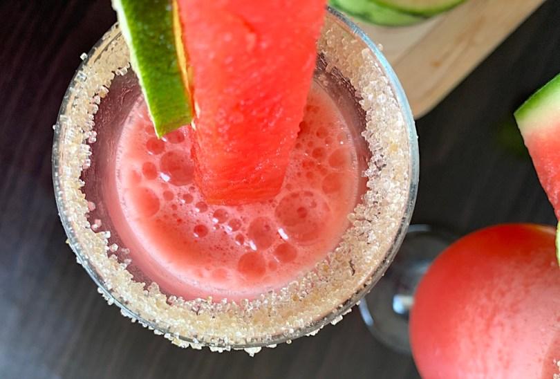 Sugar rim and garnish on a watermelon margarita
