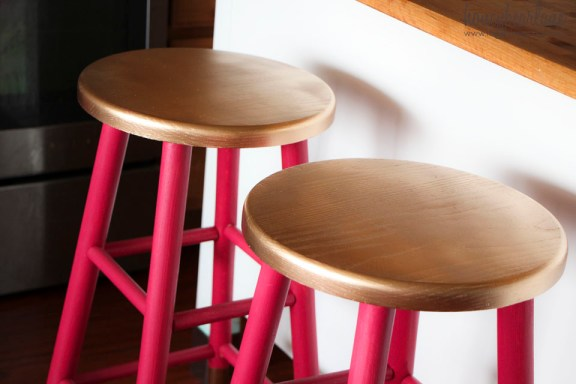 gold painted barstool seats