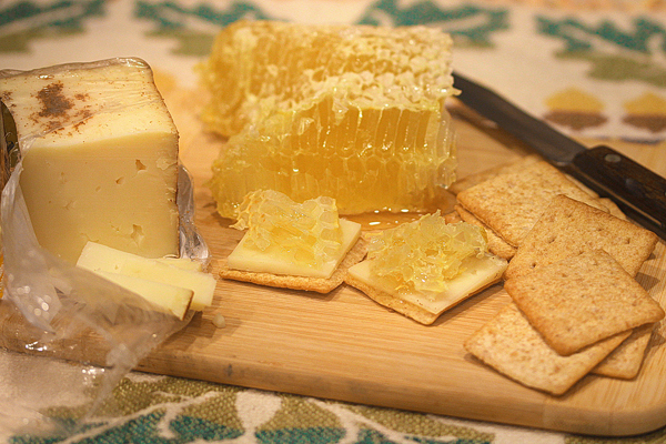 Toscano cheese dusted with cinnamon, comb honey, and wheat thins.