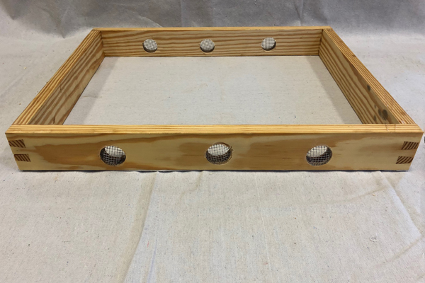A moisture quilt box with screened ventilation ports.