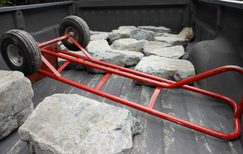 Hauling one-man rocks up the rutted hillside on a hand truck was a killer, but the project justified a pickup.