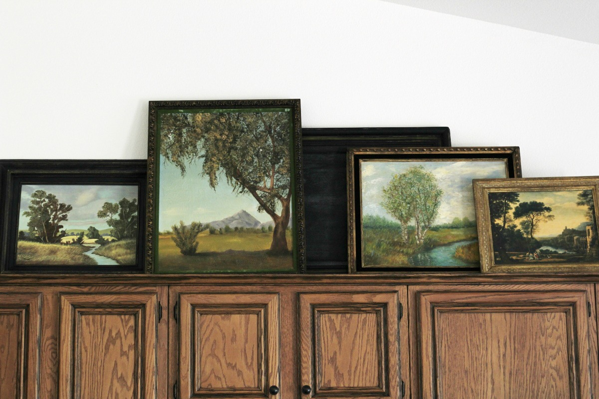 Vintage art in the kitchen, above cabinet decorating
