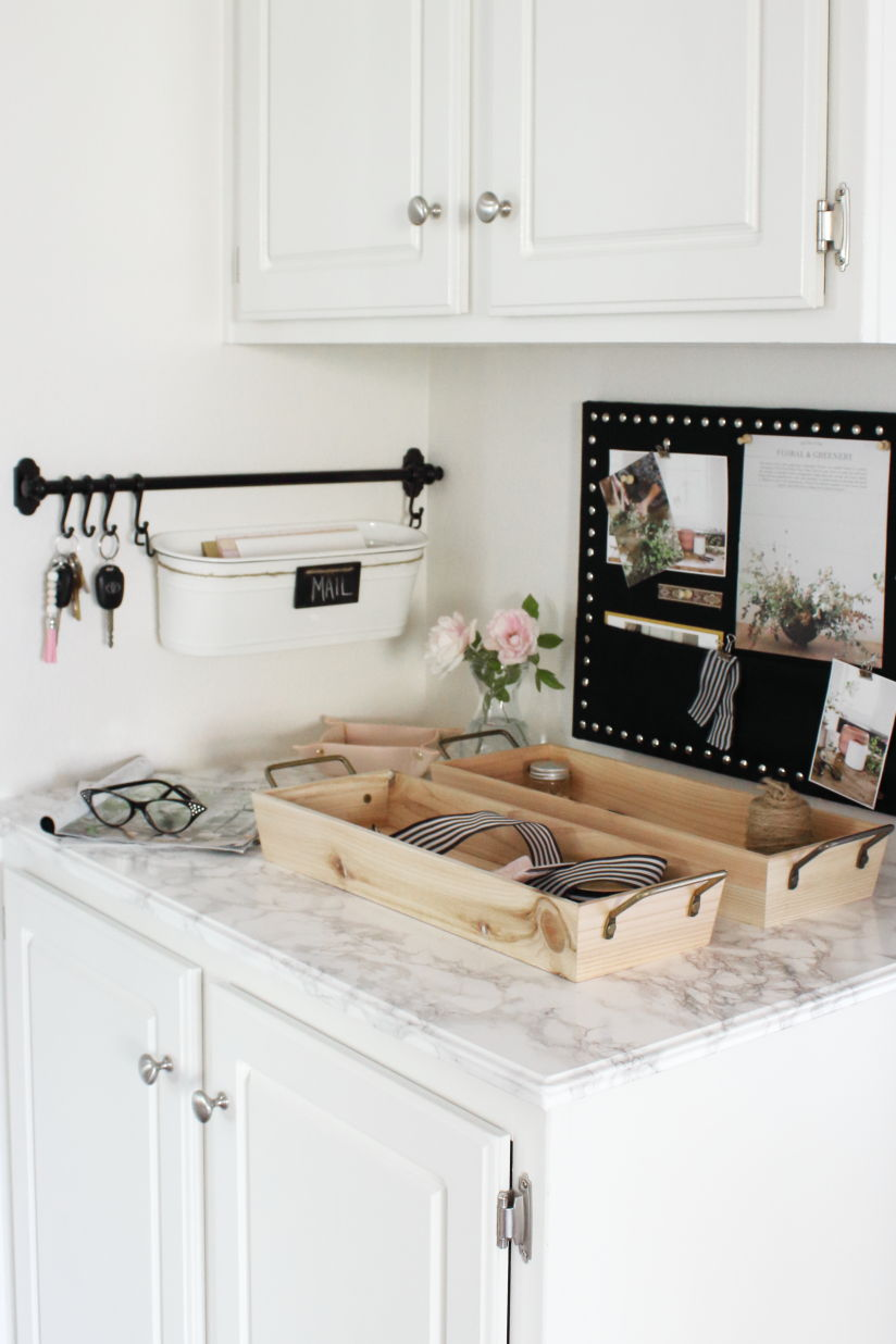 Family command center with mail caddy and key hangers and linen memo board