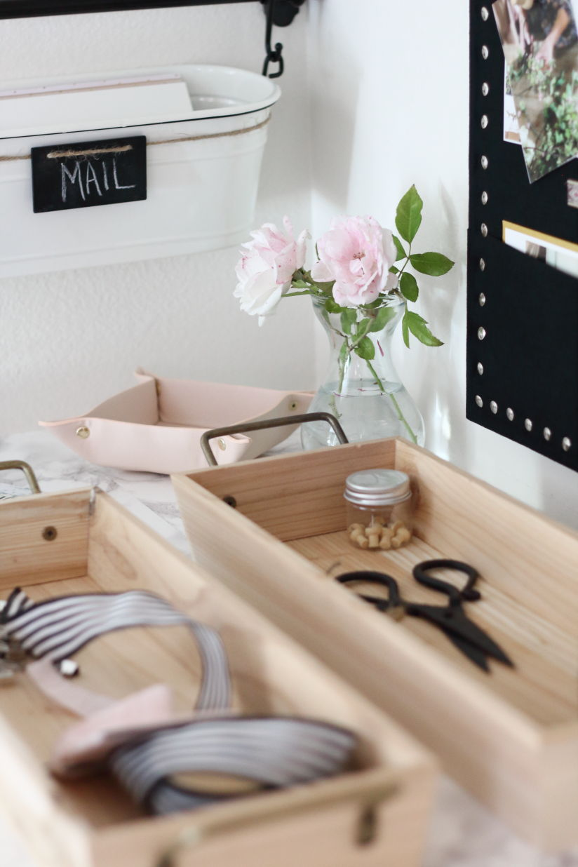 Wood trays for holding clutter in a family command center