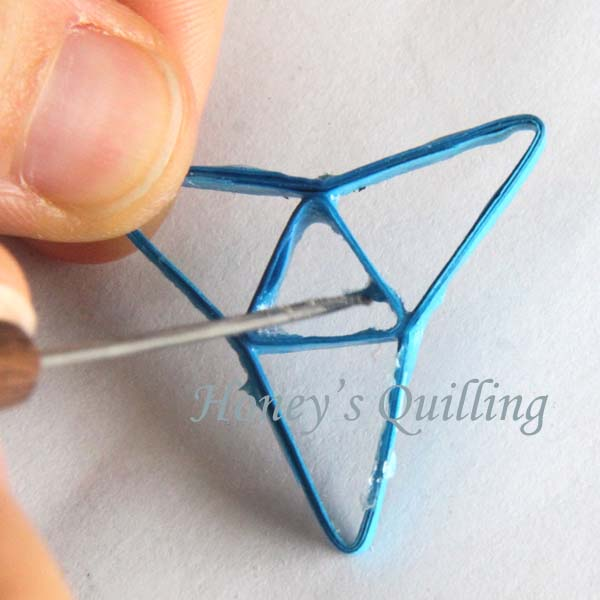 Making paper quilled jewelry - tip #11 - smoothing out a rough or ripped spot - Honey's Quilling