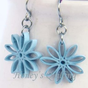 nine pointed star earrings - sky blue