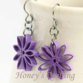 nine pointed star earrings - purple