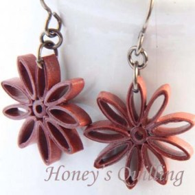 nine pointed star earrings - rust