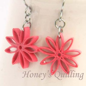 nine pointed star earrings - watermelon