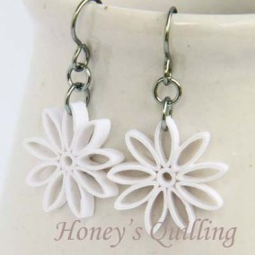 nine pointed star earrings - white