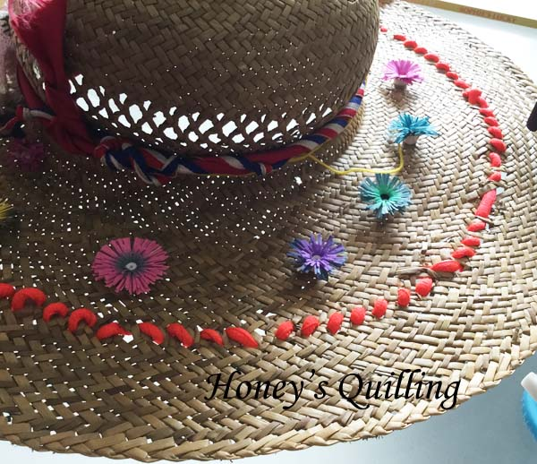 using quilled fringed flowers to decorate a hat