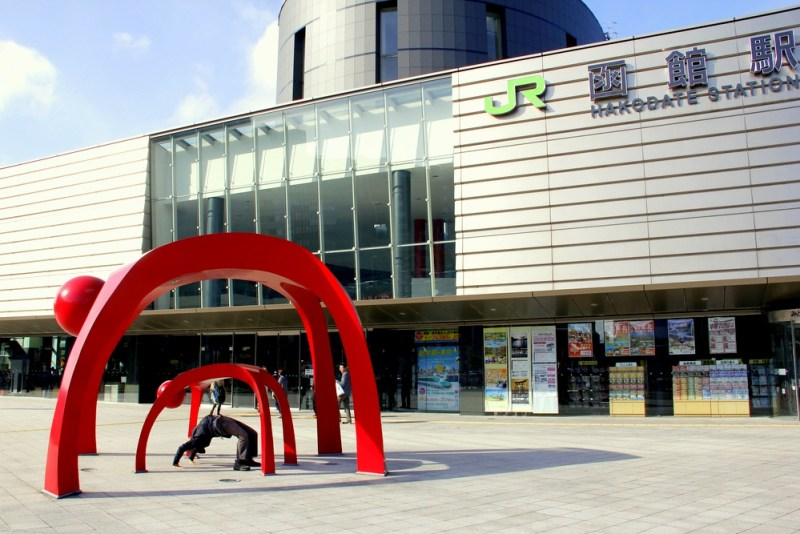 Mike becoming one with art outside the Hakodate station
