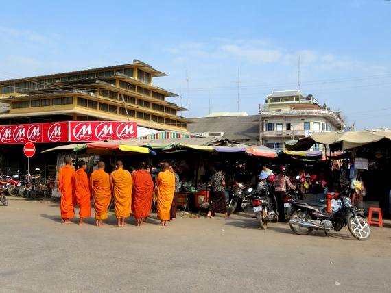 cambodian monks collecting alms