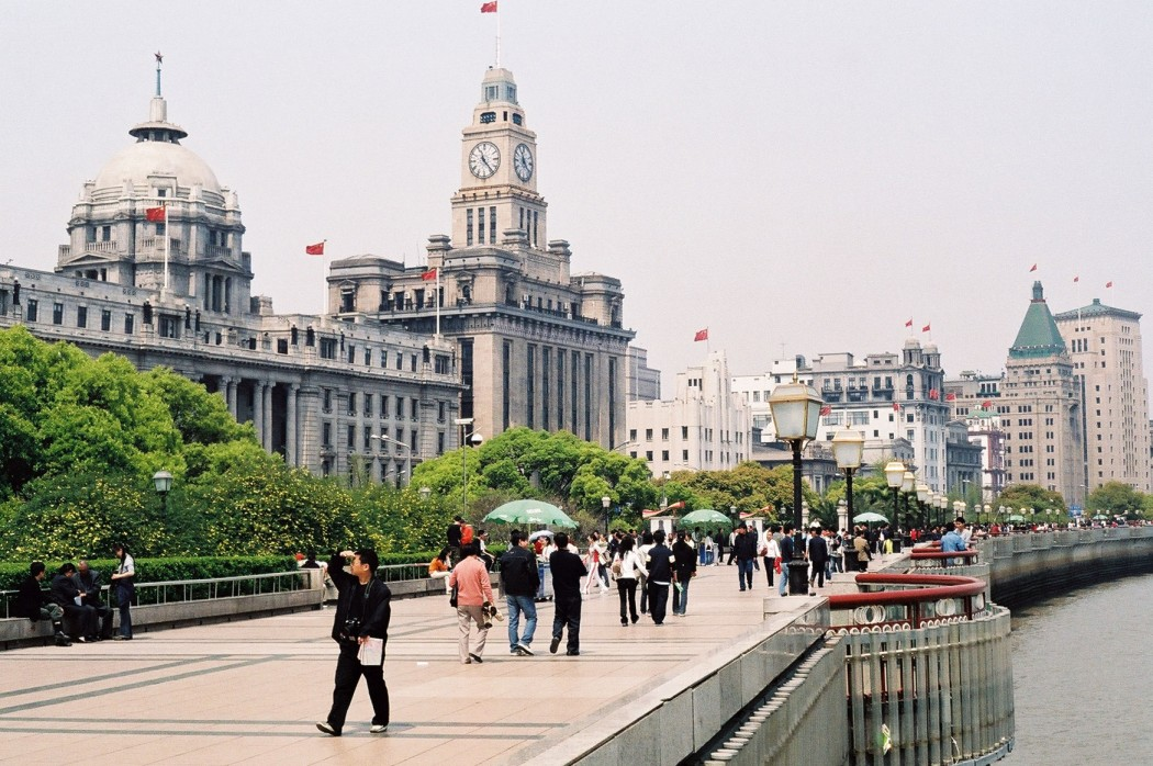 Once the city's tallest building, the Shanghai Customs House still stands over the Bund with its iconic clock tower. Photo: Wikicommons.