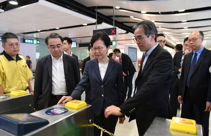 Chief Executive Carrie Lam inspects a damaged turnstile