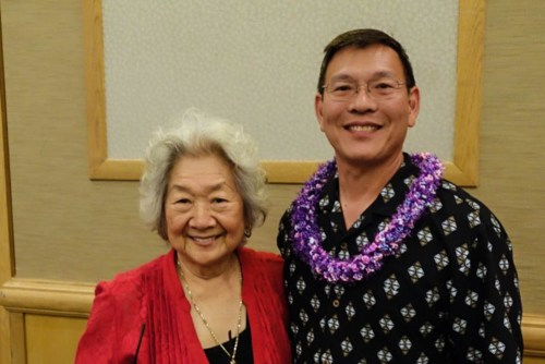 Brad Lau was presented with the Orchidist of the Year Award by President Ruth Chun.