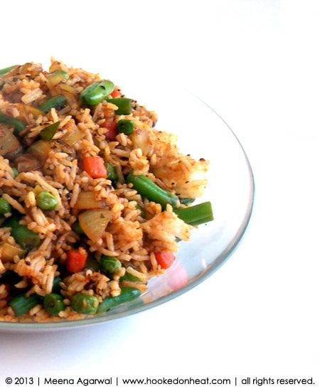Recipe for Quick Fried Rice taken from www.hookedonheat.com. Visit site for detailed recipe.