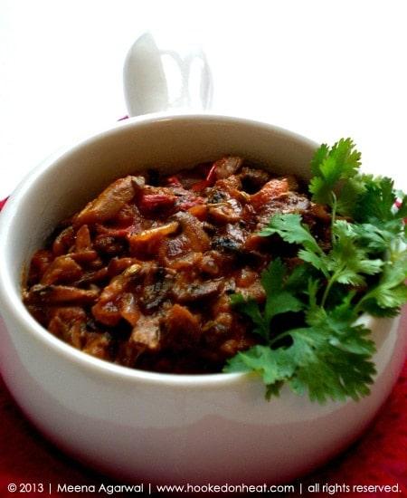 Recipe for Achari Mushroom taken from www.hookedonheat.com. Visit site for detailed recipe.