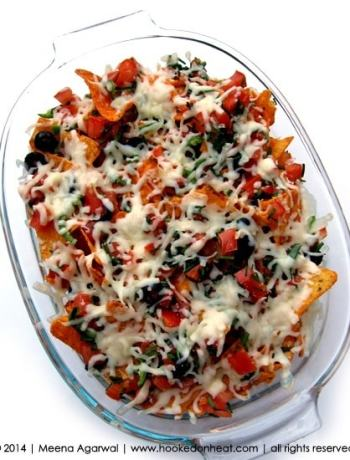 Recipe for Nachos taken from www.hookedonheat.com. Visit site for detailed recipe.