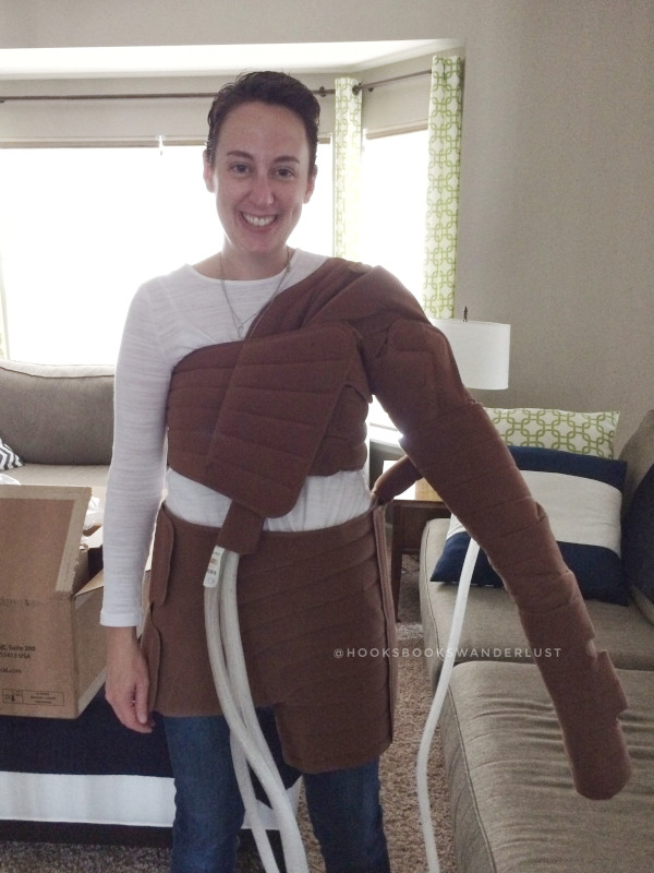 Kristen stands in her living room wearing the Flexitouch System from Tactile Medical, which helps pump and drain lymph fluid that has built up.