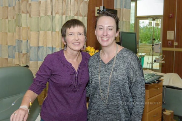 Kristen poses with a friend she met in the chemo room as she finishes her last Herceptin treatment.