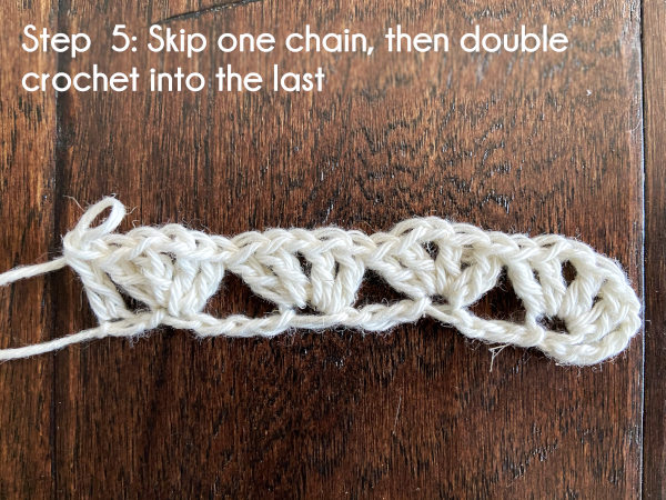 Text: Step 5: Skip one chain, then double crochet into the last.