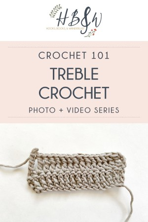 """A 2 row swatch of treble crochet in a bulky taupe yarn sits on a white background.  Dark blue text in a light pink box at the top of the image reads """"Crochet 101: Treble Crochet Photo and Video Series"""" with the Hooks, Books, & Wanderlust logo above the pink box."""