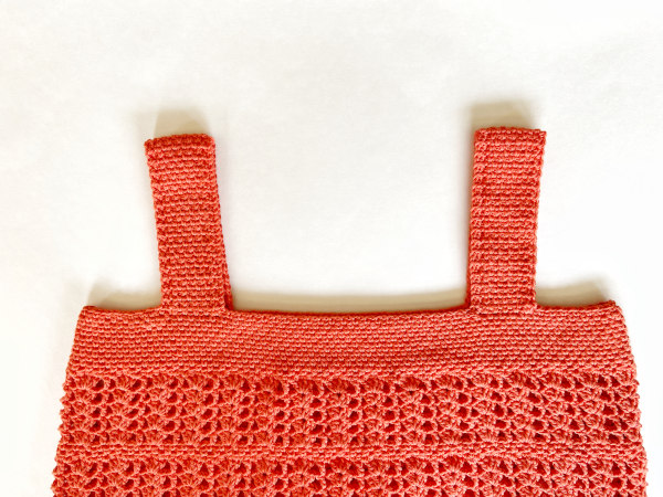 Image shows completed border worked around all neck and arm openings.