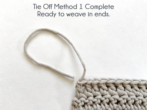"""Image shows swatch tied off and ready to weave in ends. Text reads: """"Tie Off Method 1 Complete: Ready to weave in ends."""""""