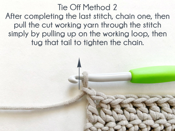 """An arrow pointing up appears to the left of the working loop and hook. Text reads: """"Tie Off Method 2: After completing the last stitch, chain one, then pull the cut working yarn through the stitch simply by pulling up on the working loop, then tug that tail to tighten the chain."""""""