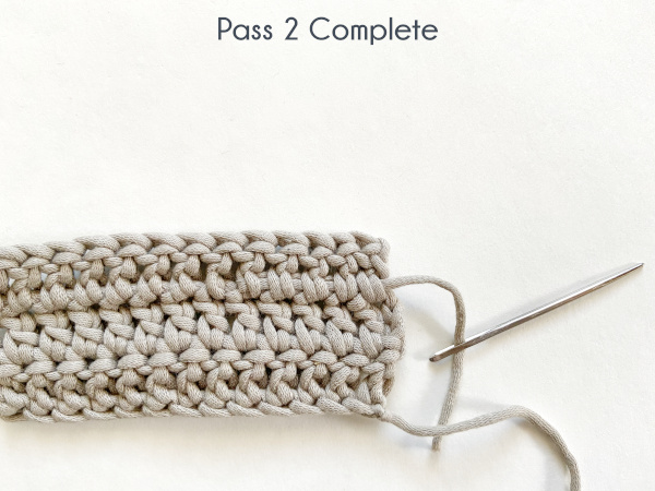 """Image shows the needle coming out of the last stitch, working right. Text reads: """"Pass 2 Complete"""""""