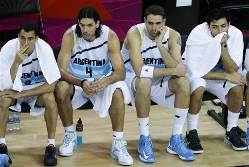 basketball players sitting on the bench