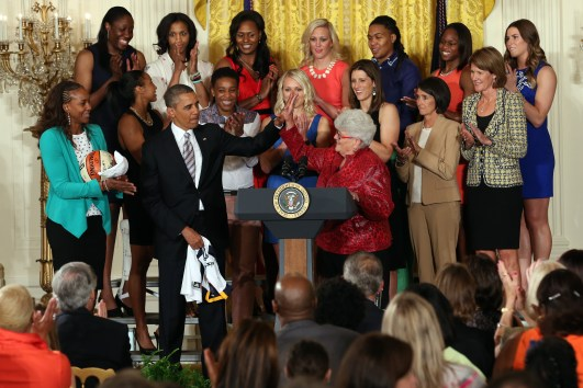 WASHINGTON, DC (June  14, 3013) -  President Barack Obama gives a high five to head coach Lin Dunn during a visit to the White House to recognize the 2012 WNBA Champions Indiana Fever. Photo: Ned Dishman/NBAE.