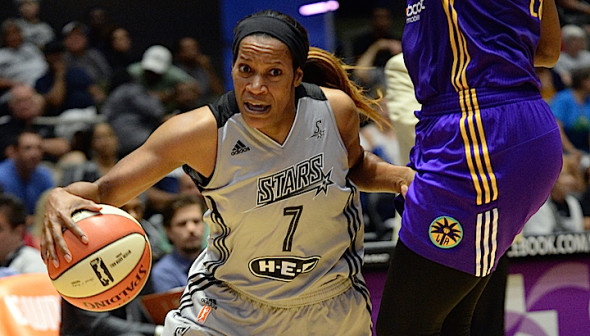 Jia Perkins of the San Antonio Stars drives to the basket against the Los Angeles Sparks  Copyright 2015 NBAE (Photos by D. Clarke Evans/NBAE via Getty Images)