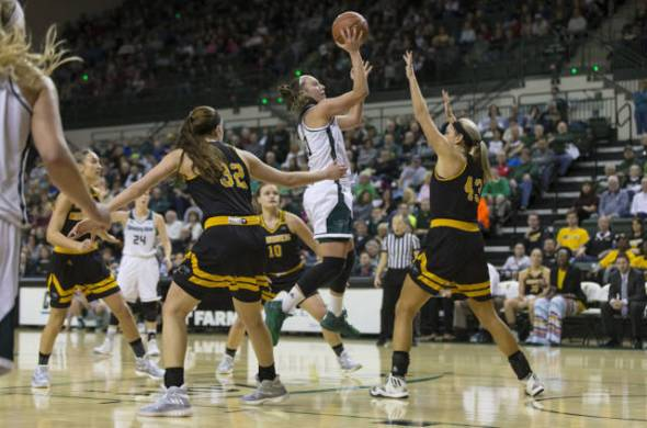 Mehryn Kraker moved into first on Green Bay's all-time three-pointers made list with 197 when the Phoenix won its ninth straight game Saturday, a 89-47 win over Milwaukee. Photo: Green Bay Athletics.