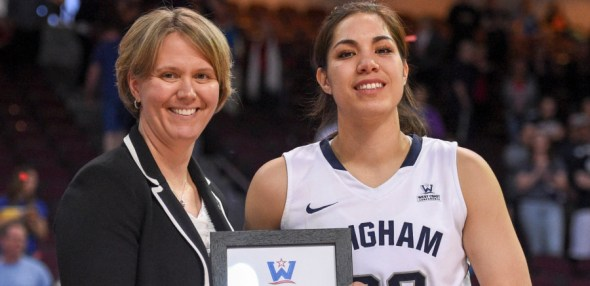 March 8, 2016; Las Vegas, NV, USA; BYU Cougars forward Kalani Purcell (32) receives her WCC All-Tournament Team award from WCC commissioner Lynn Holzman against the San Francisco Dons after the game of the WCC Basketball Championships at Orleans Arena. Photo: WCC.