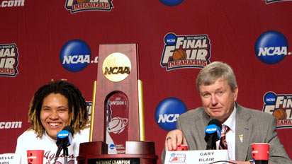 Danielle Adams and Gary Blair after Texas A&M's victory at the 2011 NCAA Championships.