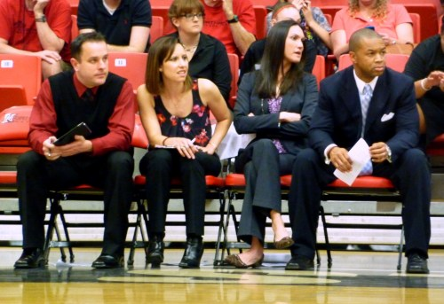 CSUN Coach Jason Flowers, far right, and his assistant coaches watch the last few moments of the game.
