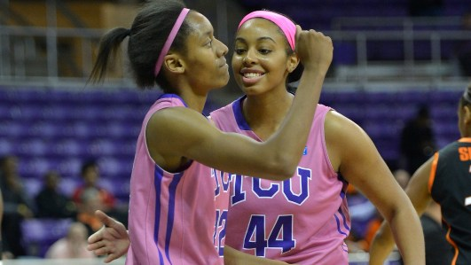February 20, 2013, Fort Worth, Texas - Delisa Gross (22) and Ashley Colbert (44) celebrate. TCU defeated No. 23 Oklahoma State 64-63. Photo: TCU Athletics.