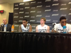 Xavier head coach Chris Mack addresses the media along with three players on Thursday (Ray Floriani photo)