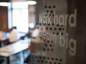 selective focus photography of work hard dream big texts on clear glass wall