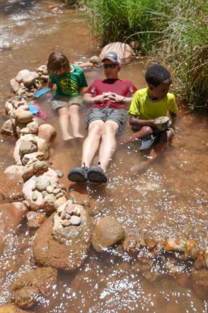 Larry and kids in creek