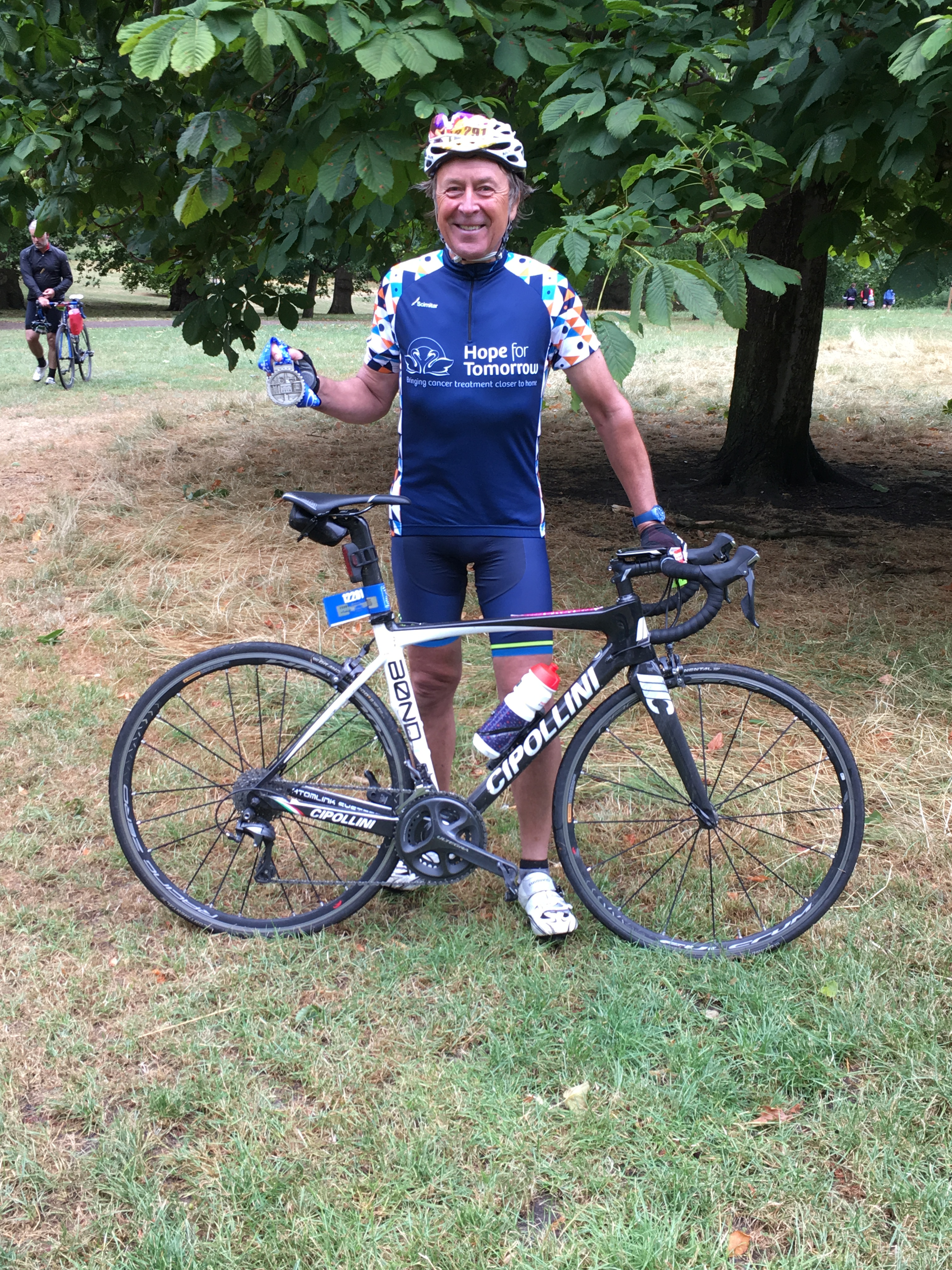 Stephen Bawtree with his medal at the finish line of the Prudential London - Surrey bike ride