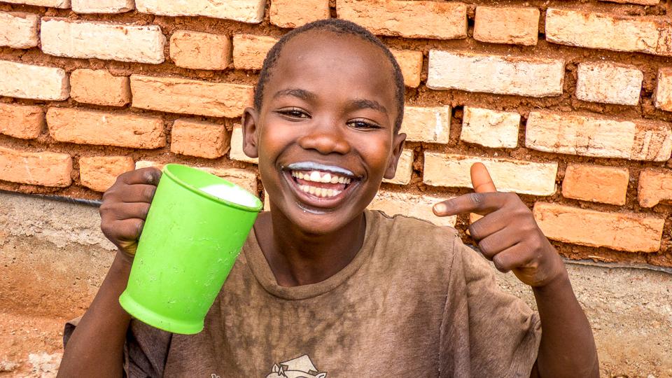 Milk Matters: Burundian boy drinking milk