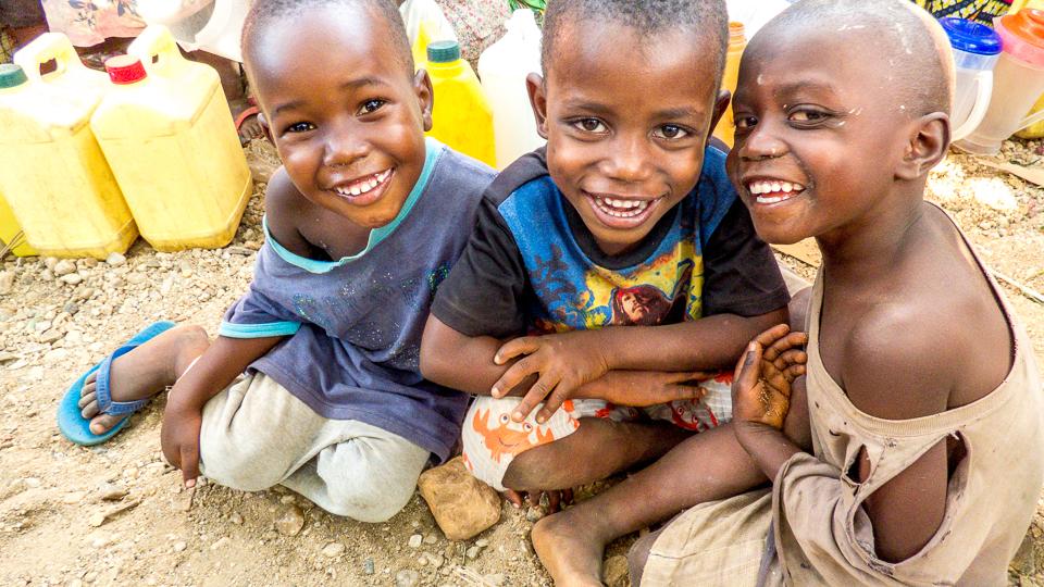 Burundian boys with milk bottles