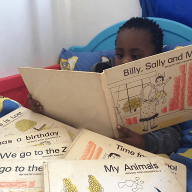 My Noah reading my Sally books - I loved these when I was learning how to read!