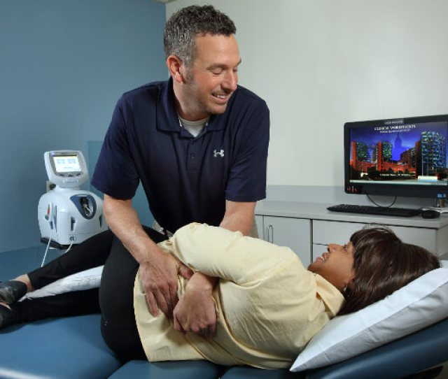 A Physical Therapist Helping Patient With Back Pain