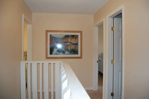 View looking at 2nd and 3rd bedroom in upstairs hall