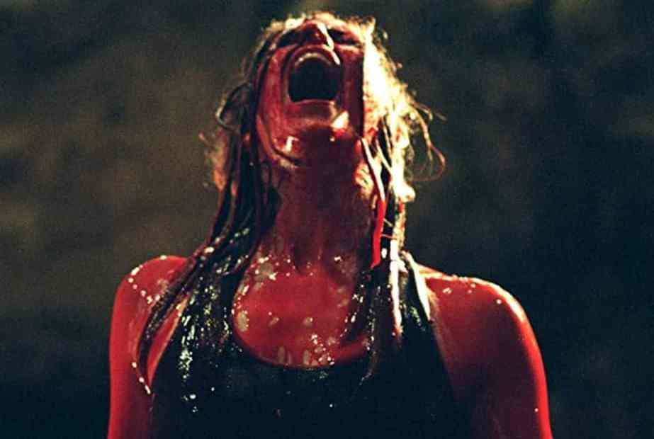 Shauna McDonald covered in blood in The Descent