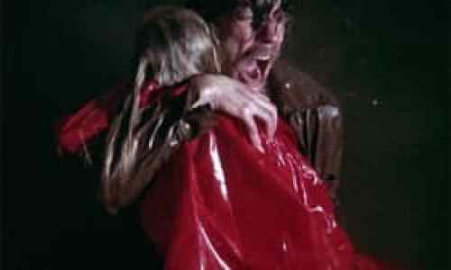John Baxter holding the drowned Christine
